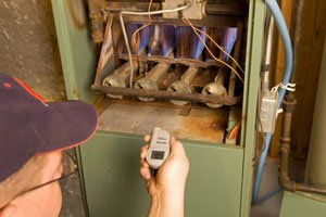 HVAC technician inspecting residential furnace