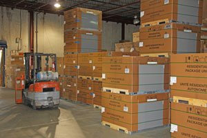 HVAC systems of various sizes sitting in warehouse