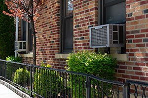 Outdoor Window Air Conditioning Units on an Old Brick New York C